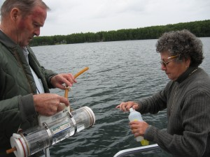Pat and Marie Sweeny take a water sample